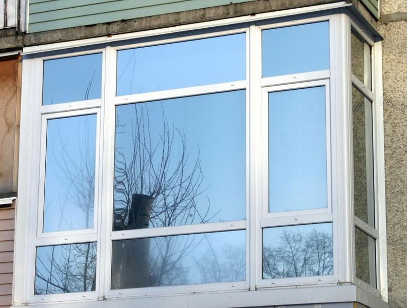 Остекление балконов с тонированными стеклами остекление балкона деревом